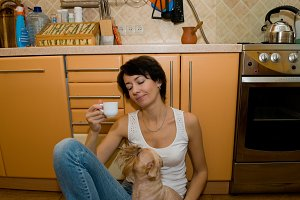 woman   has coffee on a kitchen