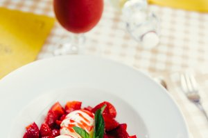 Strawberry ice cream dish with fresh strawberry with fresh juice