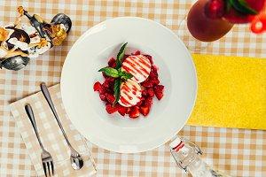 Strawberry ice cream dish with fresh strawberry