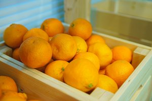 Fresh tangerines in an old box