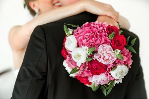 Young wedding couple. Beautiful wedding bouquet