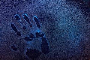 Human palm trace on frozen window