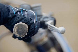 Cross motorcycle engine start. MX, close up shot of hand on handlebar