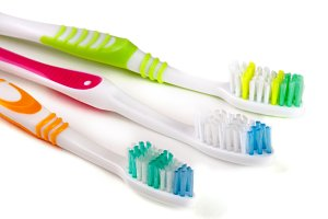 Three toothbrushes isolated on a white background closeup