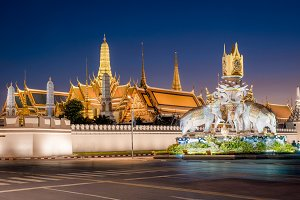 Grand palace and Wat Phra Kaew at twilight with deep blue sky in Bangkok, Thailand. Night view of famous and most visited temple of Thailand, outdoor travel photography