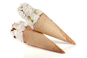 two cones of ice creams with chocolate isolated white background