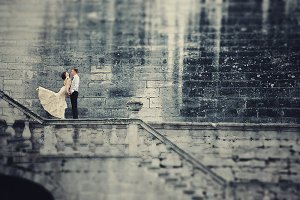 Couple standing on the handrails