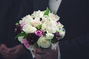 Man holds a wedding bouquet