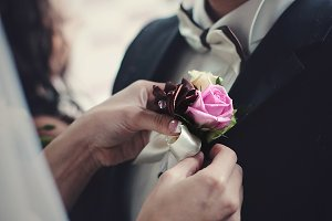 Boutonniere to groom's tuxedo