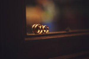 Golden rings stand on the mirror