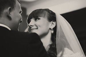 Adorable bride looks at a groom