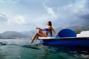 sexy woman on paddle boat catamaran