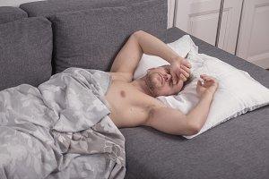 one young man bed sofa pillow sheet