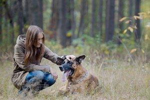 Frienship - girl and her pet in autumn park - german shepherd