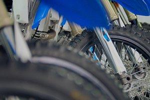 Wheels of motorcycle in the garage - enduro cross motorbike