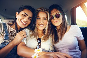 Three beautiful multiracial young women friends
