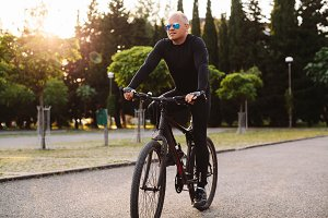 Man cycling outdoors