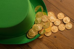 Pile of gold coins inside green hat St Patricks Day