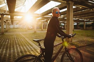 Man cycling outdoors at sunset