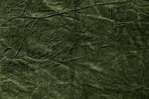 Texture of dark khaki crumpled fabric