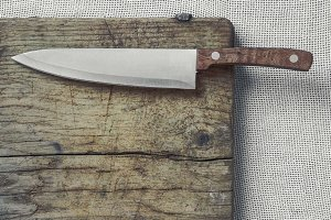 Kitchen knife with a wooden handle