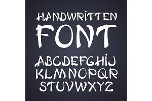 Vector handwritten brush font. White letters on chalkboard background
