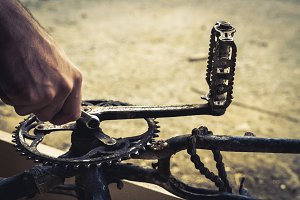 Mechanic hands repairing a bike