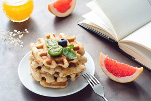Breakfast with waffles and fruits