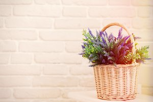 White basket with lavender flowers bouquet