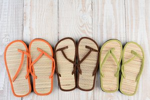 Beach Sandals on Wood Deck