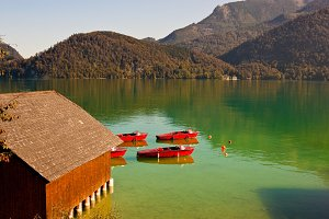 Red boats on an alpine lake.