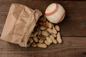 Baseball and a Bag With Peanuts