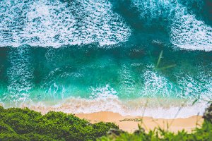 Aerial view of Waves on Nunggalan Beach on Sunny Day, near Uluwatu, Bali, Indonesia