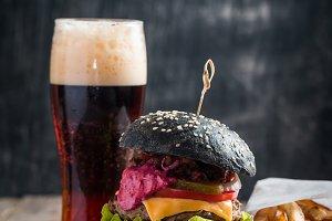 Homemade burger with black bun