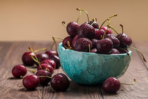 Cherries in a bowl with water drops