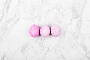Pink Easter eegs on marble