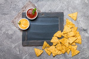 Mexican nacho with sauces and chalk board