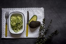 Fresh zucchini on a black background