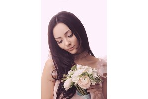 Bride. Asian female with wedding bouquet
