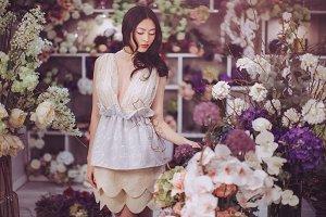 Asian woman in flower shop