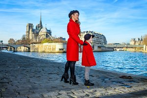 mother and daughter travellers in Paris looking into distance