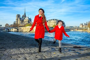 mother and daughter tourists in Paris having fun time