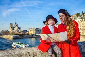 mother and daughter travellers in Paris looking at the map