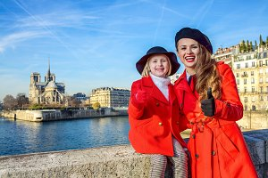 mother and daughter travellers in Paris showing thumbs up