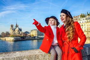 mother and daughter travellers in Paris pointing at something
