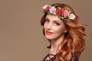 Beautiful Curly Redhead in Fashion Flower Wreath