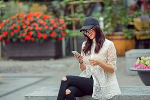 Beautiful asian young woman portrait using smartphone in the city