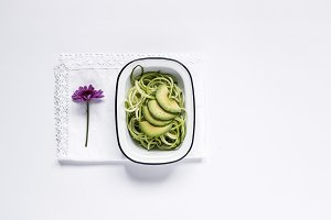 Fresh zucchini on a white background