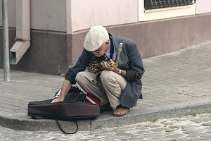 Street saxophonist is old men