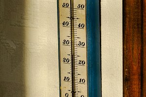 Old thermometer on wall